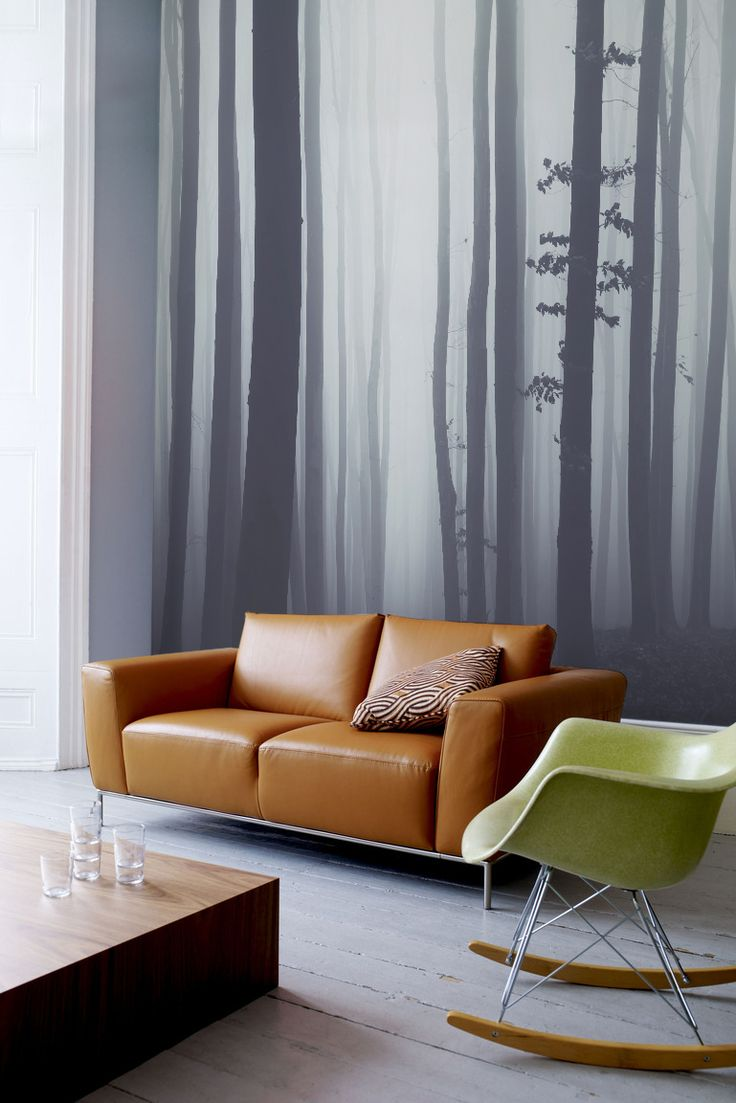 Create an accent wall in your living room with this forest wallpaper mural. This is a beautiful grey wallpaper design that creates a calming atmosphere in your home.