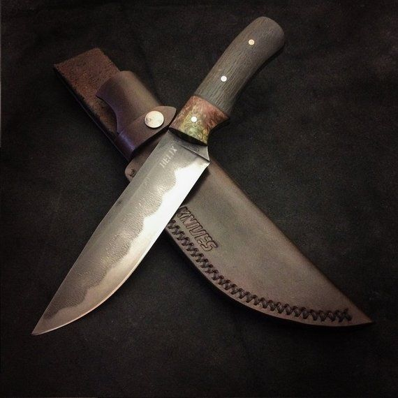 The Blade Is Made Out Of 1095 Carbon Steel It Has A Rough Etched Finish Which Reveals The Hamon In The Steel The Handle Is Stab Knife Cool Knives Knife Sheath