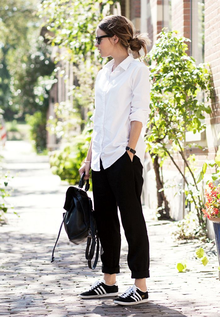 Christine Reehorst of Fash n Chips wearing a white button-down, black cuffed trousers, and black and white sneakers