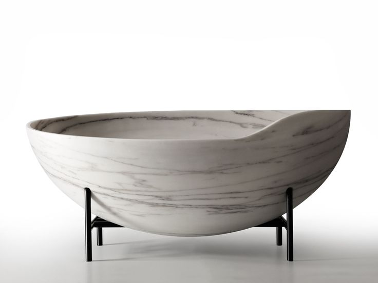 kreoo cuts kora bathtub from a single marble block