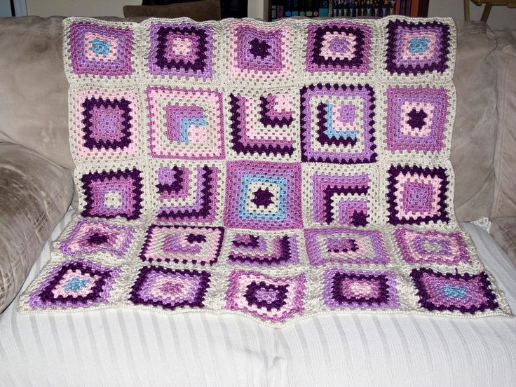My own version inspired by the blanket found here. http://bigalittlea.com/2012/09/17/mitered-granny-square-baby-blanket/