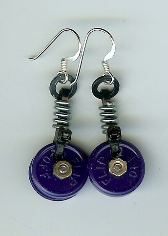 """Felice's Pieces. Earrings made from dog vaccination vial lids. Don't you love how they say """"flip off"""" on them?"""