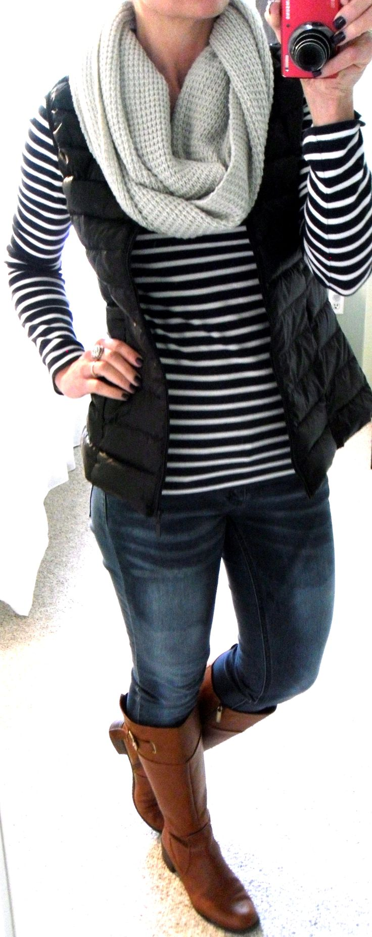 H&M blue and white striped top, BCBG gray knit infinity scarf (from Macy's), H&M black down puffer vest, distressed skinny jeans, Bandolino cognac boots