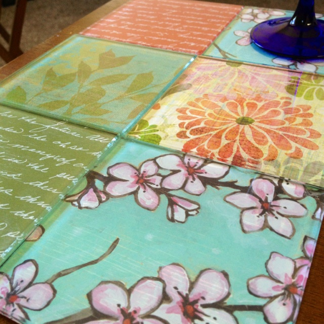 Modge podge scrapbook paper to glass tiles and make coasters custom to your style!