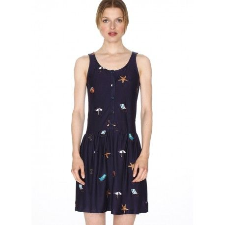 Sleeveless top with round neckline and bows detail on the back. All-over embroidered details. Color: Navy.