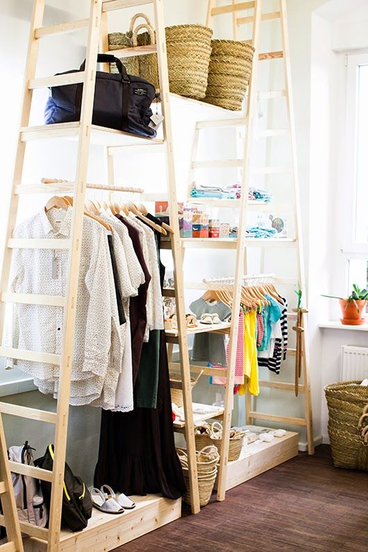 Art And Chic  Using a wooden ladder as hanging space or put as shelves