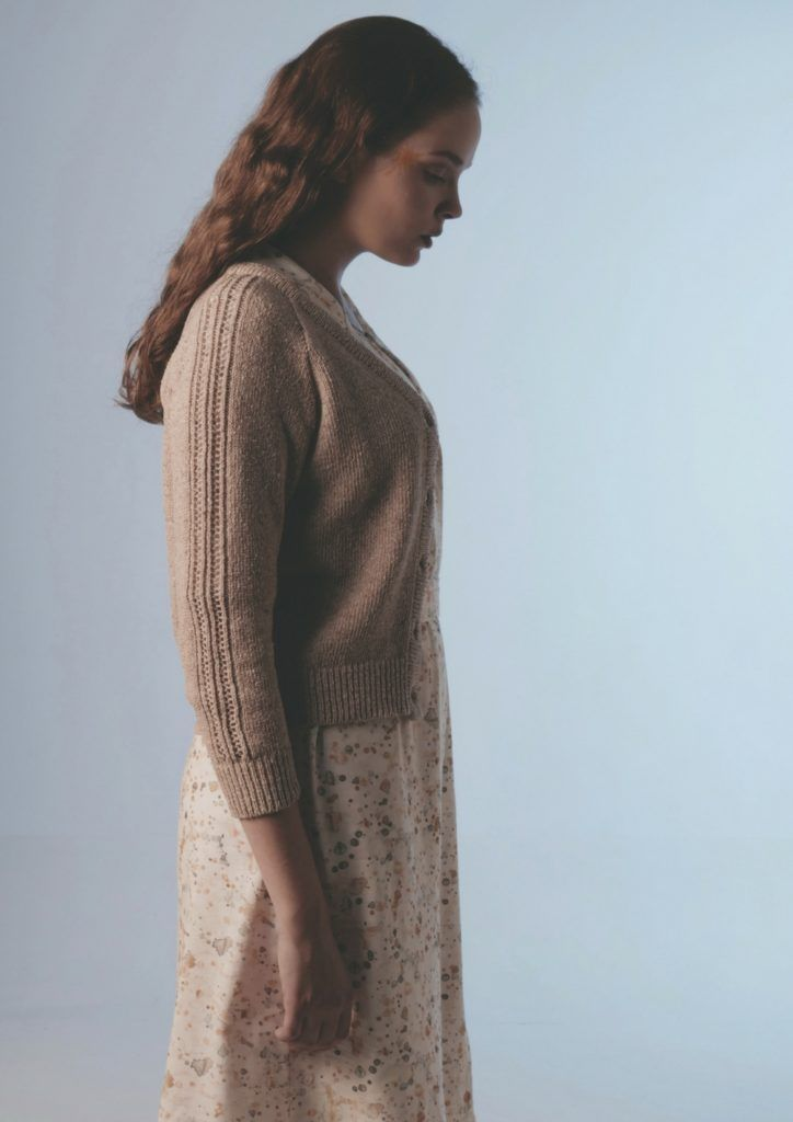 Classic cardigan with buttons in front and elbow long sleeves. Subtle colours and beautiful lace knit details in front.