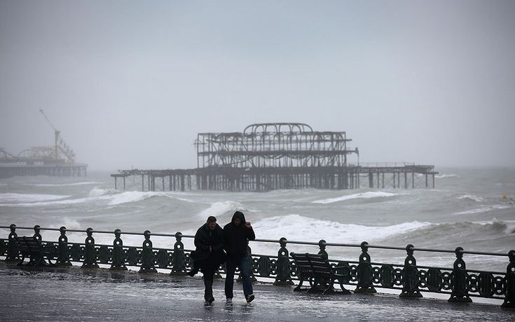 Walkers battle rain and high winds on Brighton seafront