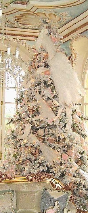 Stunning Formal Christmas Tree - via Castles, Crowns and Cottages. Check out how long that tail is on the bird at the top of the tree!