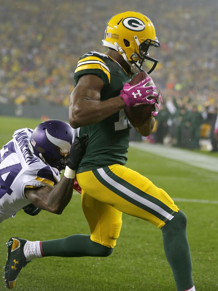 Green Bay Packers wide receiver Randall Cobb scores a touchdown against Minnesota Vikings' Captain Munnerlyn in the first quarter. This would make a cool Topps card.