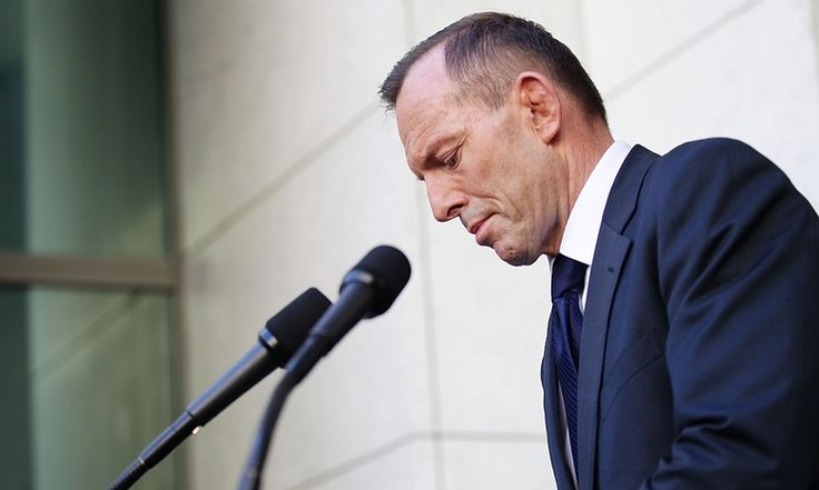 """The most enduring image of his political career deserves to be that of him addressing an ageing crowd on the lawns of parliament house, with signs behind him calling her a """"bitch"""" and a """"witch""""."""