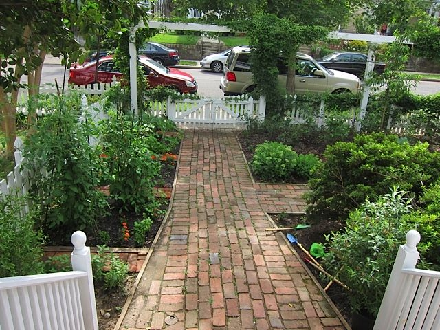 front yard edible gardens stone pathway idea to front door with garden beds on both sides