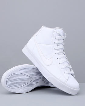 Nike hightops.  White.  These are the only shoes I wore for years in high school.  Everyone had them and everyone had smelly feet.  Few of us actually played basketball but it didn't matter.  I even swam with them a few times in the lake which may explain the unique aroma.