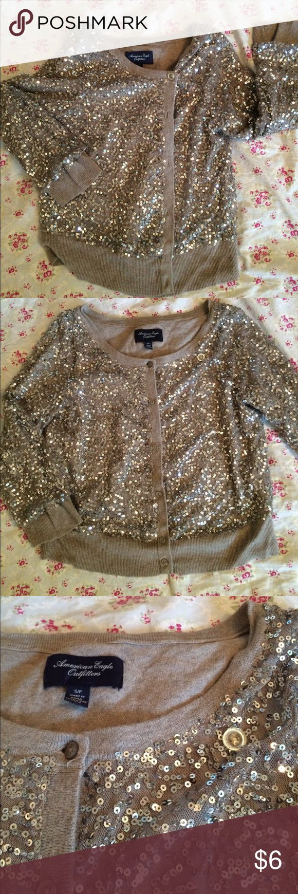 Sequin cardigan Women's Small! AEO American Eagle Tan sequin three-quarter length sleeve sequined cardigan from American Eagle outfitters another button was added so that it can be more dressy the first picture shows this added closure. The second picture shows the cardigan more casual. American Eagle Outfitters Sweaters Cardigans