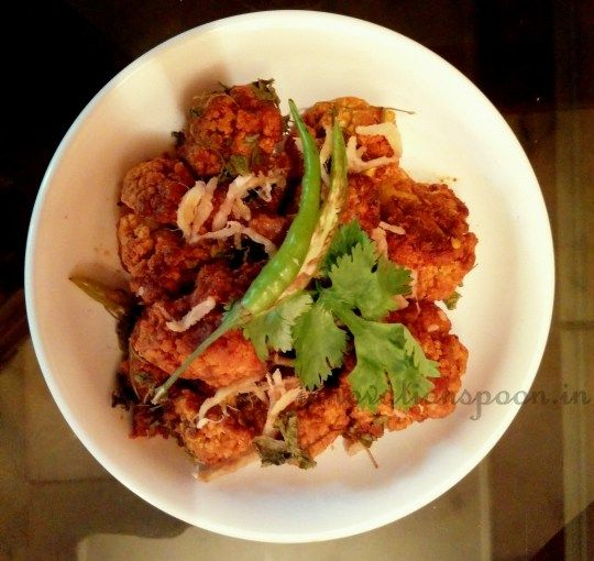 Golden Baked Cauliflower | Cauliflower florets are dressed up with a few seasonings and baked to tasty perfection  which helps to preserve the taste and flavours of the masala.