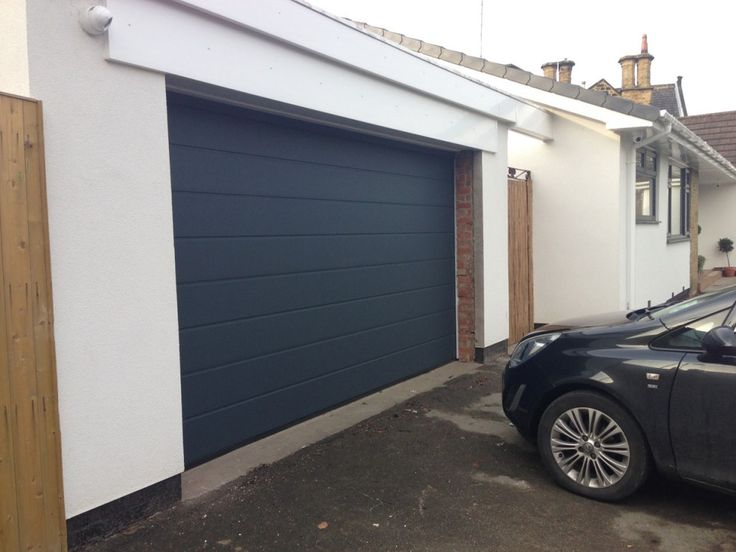 Hormann M Ribbed Sectional Garage Door By ABi Hormann M Ribbed made to measure insulated sectional garage door finished in Anthracite Grey. Installed in Wakefield: http://abigaragedoors.co.uk/garage-doors-wakefield/.