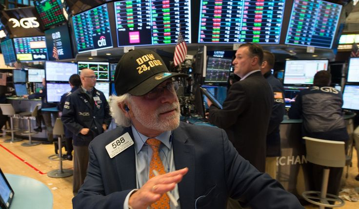 Wall Street's crash in 1987 has an ominous parallel with today's global markets:  A trader wears a DOW 23,0000 hat while working on the floor at the closing bell at the New York Stock Exchange on October 18, 2017 in New York. Photo: AFP