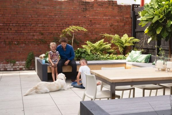 The backyard table is Nicole's design, and is built from vitex timber that will naturally grey with age; the Air chairs ...
