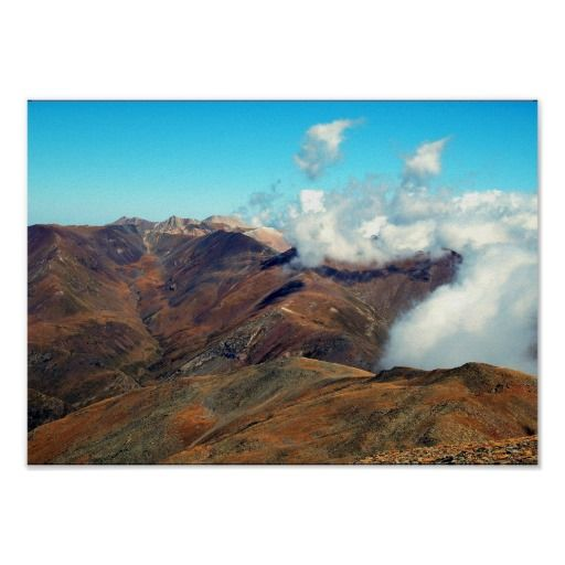 Scenic mountain view with blue sky and clouds poster