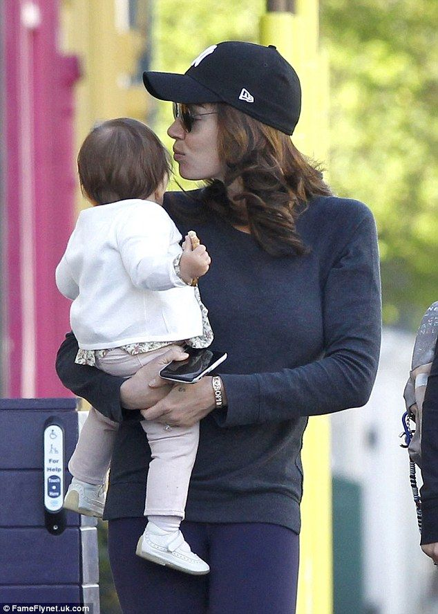 Tamara Ecclestone cradles Sophia as she steps out with Petra Stunt #dailymail