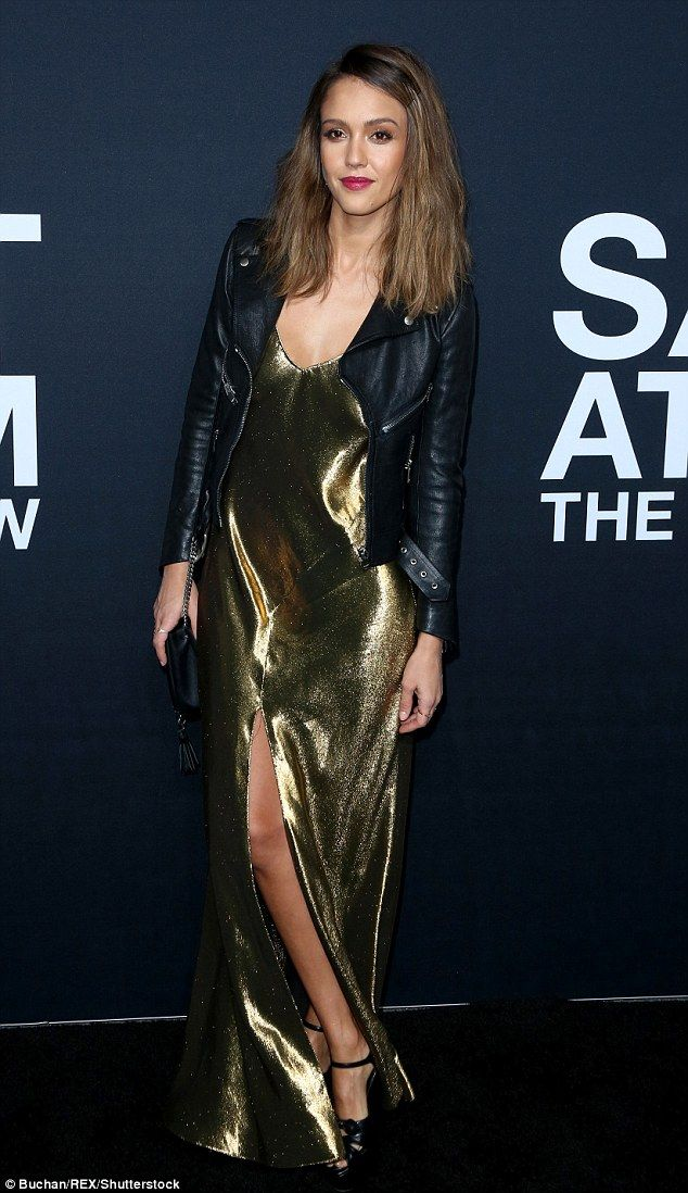 Jessica Alba lit up the night in a slinky gold number with a center slit as she attended Saint Laurent at the Palladium in Los Angeles