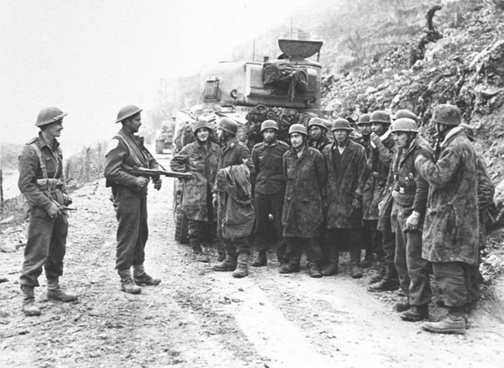 """New Zelanders detain German paratroopers fighting as infantry during the Battle of Monte Casino in Italy. The Germans are definitely in no """"war face"""" mood. Long gone is the spark of the air landing/parachute division."""