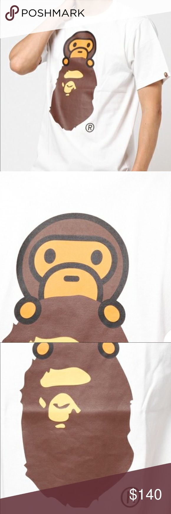 """A Bathing Ape, BAPE, Milo On Ape Head Tee Popular lineup that BAPE's mascot character """"BABY MILO"""" was printed appeared. I am finished in a design that can taste the taste of BAPE to its fullest. 100% Authentic, Imported from Japan, Runs small, size up. A Bathing Ape, BAPE Shirts Tees - Short Sleeve"""