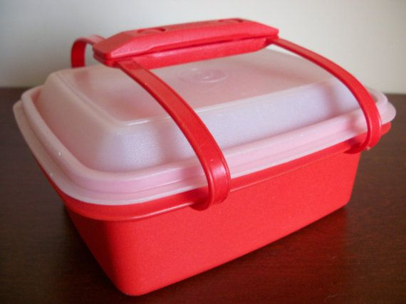 Red Tupperware lunchbox from the early 80's! I still have this!  I thought it was a half gallon ice cream container cuz that's what my mom used it for. :)