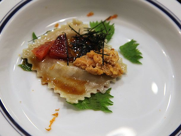 Uni-Miso Raviolo  Liquid uni and miso broth is inside the raviolo that comes topped with blood orange, tare, and sea urchin with shiso and orange zest.