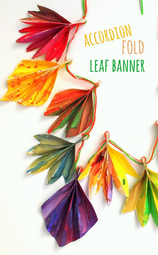 Accordion folded autumn paper leaf banner.