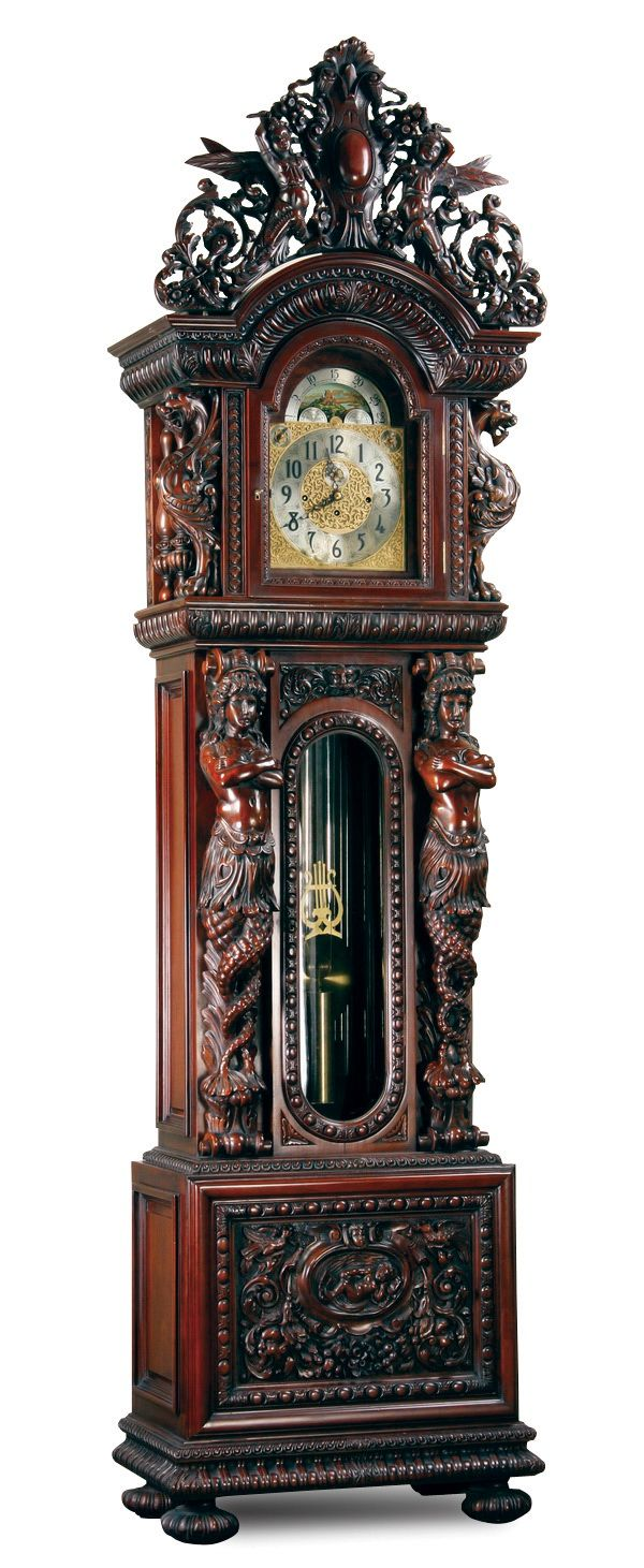 Extravagantly carved mahogany figural tall case clock, after R.J. Horner, with pierce carved arched crest supported by winged gryphons, surmounting fully formed maiden term figures, with a Herschedes 9 tube moon phase movement