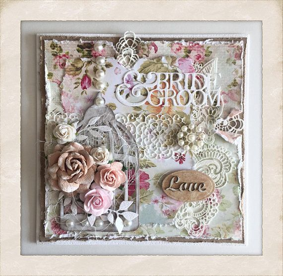 """This stunning, personalised Wedding card measures approximately 7"""" square and comes with a coordinating white presentation box ready for giving. Created in a shabby style design using white textured card stock with several layers of shabby design card, birdcage, faux lace, pink,"""
