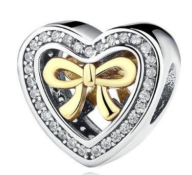 Stříbrné korálky/ přívěsky : Stříbrný korálek - Srdce se zlatou mašlí pozlaceno 14kt zlatem