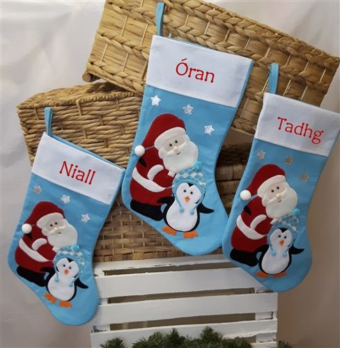 Personalised Baby's 1st Christmas Stocking for boys. Featuring festive Santa and a cute penguin. WowWee.ie | €13.99