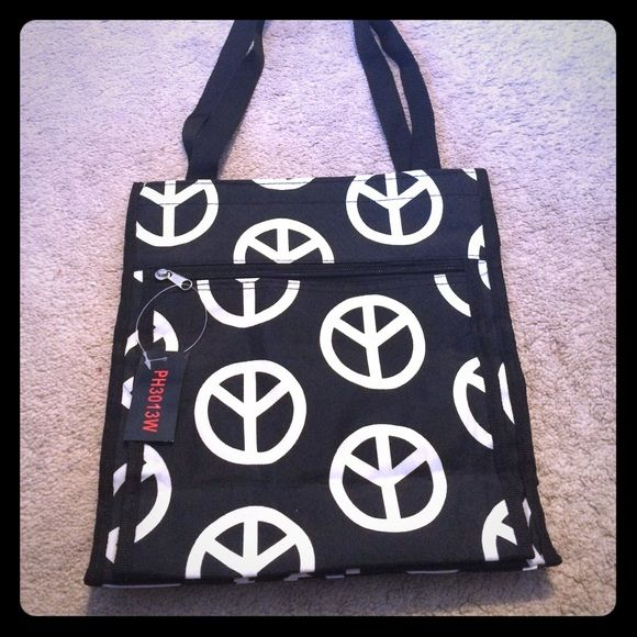 Upside down Peace Sign Tote Handy black tote with white peace signs. NWT.  It comes with an attached water proof coin purse. It has sturdy black straps and closes with Velcro. Inside is a black lining, the coin purse and a zipper to also close the bag. Outside there is a Velcro'd pocket as well. Bag is brand new and in perfect condition. Bags Totes