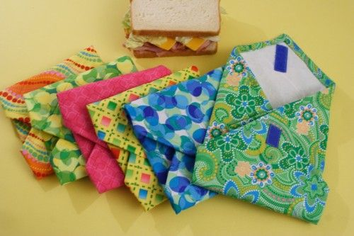 This is a reusable sandwich baggie. It looks like it would be super easy to make and I think I even have some fabric I can use for it... And you can put a note inside for them to see everytime they eat a sandwich...