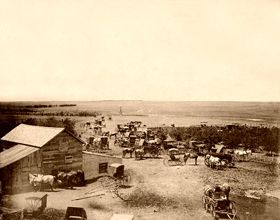 Cowboys and wagons gather in Dodge City in the late 1800's. #kansas