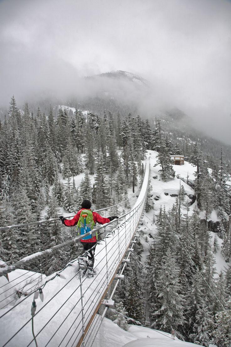 Snowshoeing across suspension bridge, Sea to Sky Gondola, Squamish BC