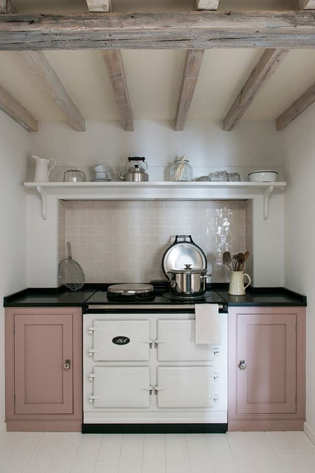 Middleton Bespoke Kitchen units painted in Mylands eggshell paint, colourway 'Eccleston Pink'. White AGA.