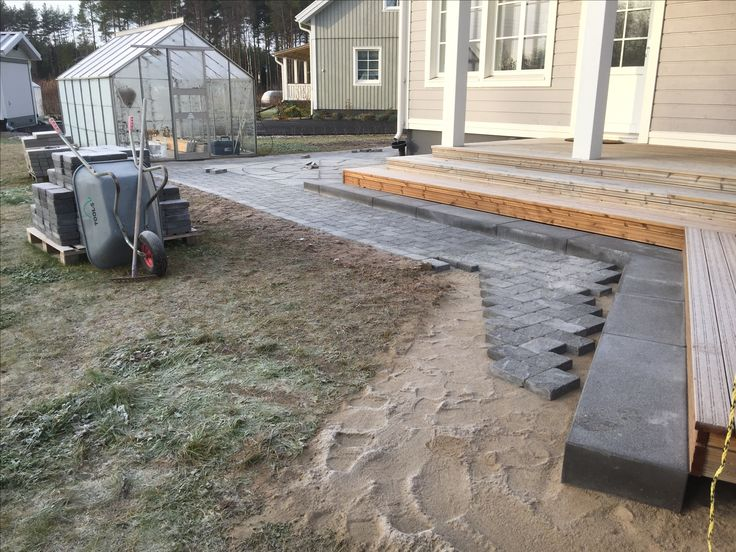 Making of Pavered path using Benders Troja Antik Graphite and Labyrint side of same brick as border. Stairs are Benders blocks.
