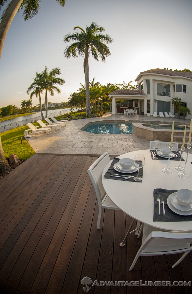 Imagine having fabulous dinner parties in this backyard. You could with gorgeous decking like exotic Advantage Massaranduba™! AdvantageLumber.com ® #massaranduba #decking #porch #patio #pool #exotic #tropical #saltlife #FL #weston #florida
