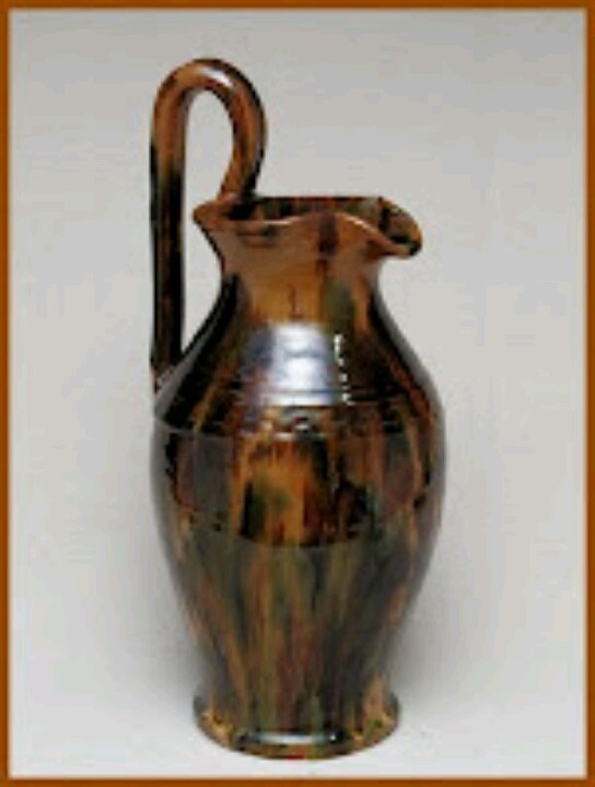 Rebecca Jug (also known as the Rebecca Pitcher). This example by Joe Owen illustrates the essential elements: rounded on the lower body, necked in above, a widened rim shaped to form a spout, & an added handle.