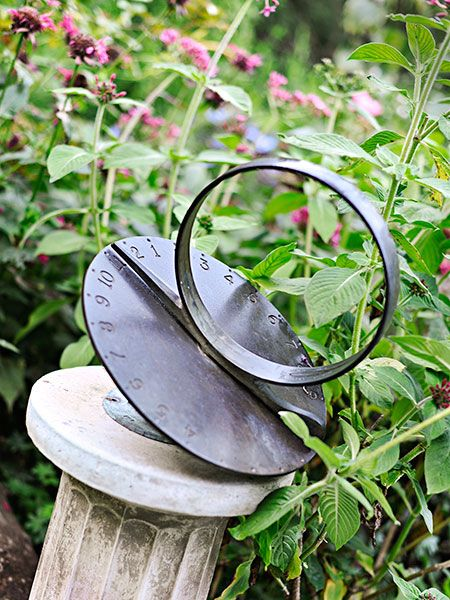 If you don't love statues and fountains but you want to bring art into your garden, try a sundial. Simple in form and with a storied history, sundials work in urban, rustic, and contemporary gardens.