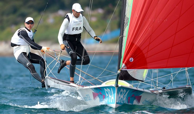 France's Emmanuel Dyen and Stephane Christidis (R) head to victory in race one in the 49er sailing class at the London 2012 Olympic Games, in Weymouth on July 30, 2012. AFP PHOTO/William WEST (Photo credit should read WILLIAM WEST/AFP/GettyImages)