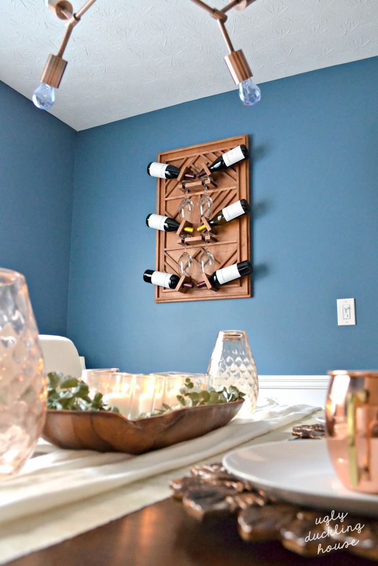 This plywood art wine rack is the exact addition my dining room needed; it adds warmth, a contemporary feel, and function for lots of entertaining. #ad  #woodworking #winerack #winenight #wine #plywood #diningroomideas #ednavalleyvineyard