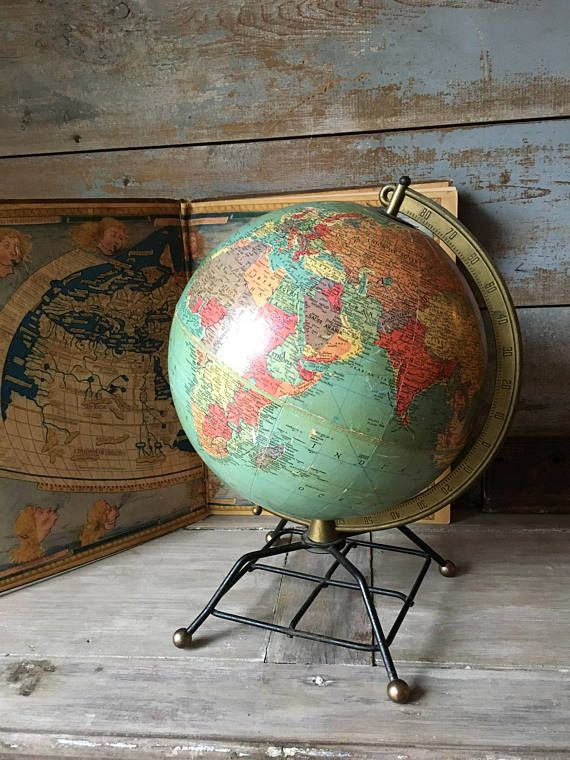 Another great vintage Replogle globe. 10-inch globe one a unique iron stand. It is in good vintage condition with some minor yellowing of the paper and minor scuffing. Perfect for the man cave or globe collection. Measures: 15 high with stand. A unique product. A unique company. A unique story. From the humble beginning in a Chicago apartment, Replogle today is the worlds largest globe manufacturer. Their expert cartographers and craftsmen ensure the most accurate information and…