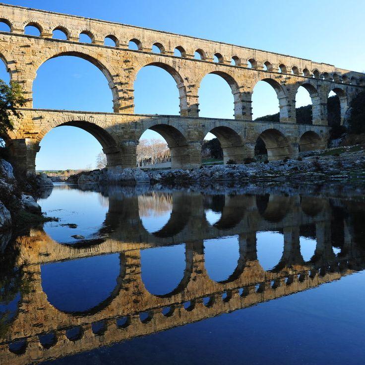 Vers-Pont-du-Gard Vers-Pont-du-Gard, France sky building bridge outdoor reflection landmark water River arch bridge aqueduct nonbuilding structure ancient history arch