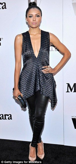 Kat Graham at the MaxMara and W Magazine cocktail party in tight leather pants and a low cut, flowy tunic top http://dailym.ai/1u769qu