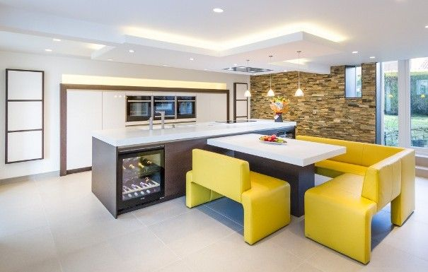 We're seeing a surge of modern SieMatic kitchens with pops of yellow accents - this family matched cabinets in Lotus White and Truffle Brown Pine with vibrant yellow leather seating - via Stuart Frazer in the UK
