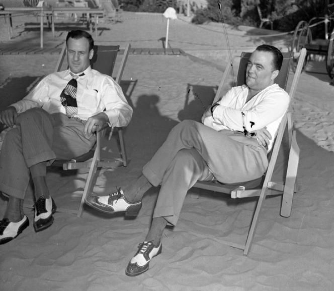 FBI Director J. Edgar Hoover and his good friend Associate Director Clyde Tolson sitting in beach lounge chairs